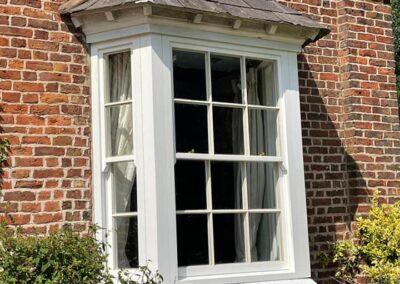 Fully finished sliding sash windows in Sapele hardwood